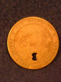 New Hampshire Public Works and Highways token. Showing the Old Man of