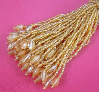 Set of FOUR Glass Beaded Gold Napkin Rings / Tassels