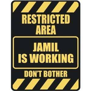 RESTRICTED AREA JAMIL IS WORKING  PARKING SIGN