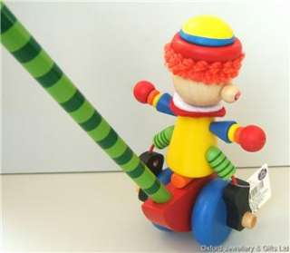 TRADITIONAL, CHILDS WOODEN PUSH ALONG  CYCLING CLOWN