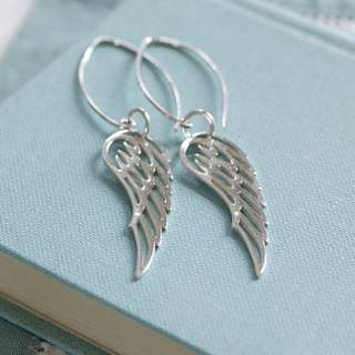 Beautiful sterling silver angel wings hung from dramatic silver loops