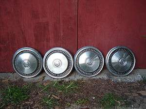 SET OF 4 VINTAGE 70S FORD TRUCK WHEEL COVERS 15 INCHES